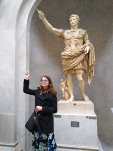UMW senior Ruth Wilmot poses with the Primaporta Augustus statue, honoring the first emperor of the Roman Empire, during a study abroad trip to Rome prior to the pandemic. Mary Washington's classics program just earned the top spot on a student-curated list in College Magazine.